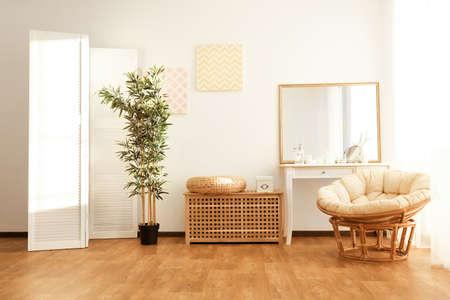 Light room interior with folding screen Фото со стока