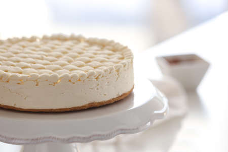 Delicious plain cheesecake on stand
