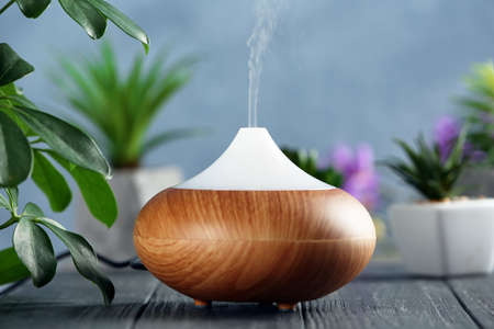 Aroma oil diffuser on wooden table Stock Photo