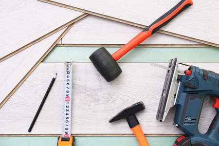 Laminate installing equipment on planks