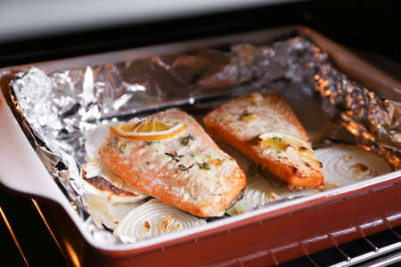 Baking dish with delicious roasted salmon fillet Banco de Imagens