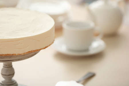 Delicious cheesecake on stand