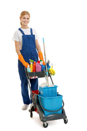 Beautiful woman with cleaning equipment on white background
