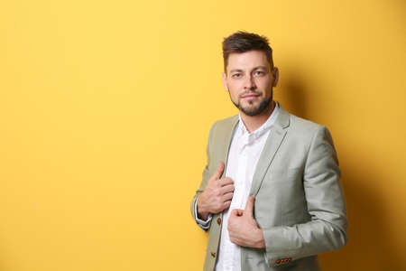 Handsome young man posing on color background Stock Photo