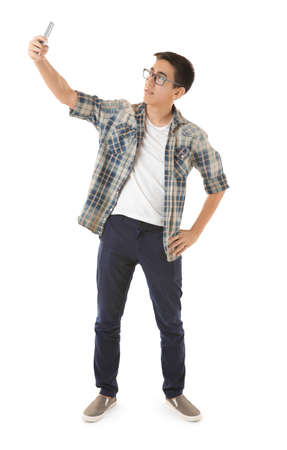 Young Asian man taking selfie on white background Stock Photo