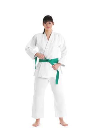 Young sporty woman in kimono on white background