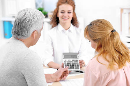 Insurance agent showing calculator with value of benefits