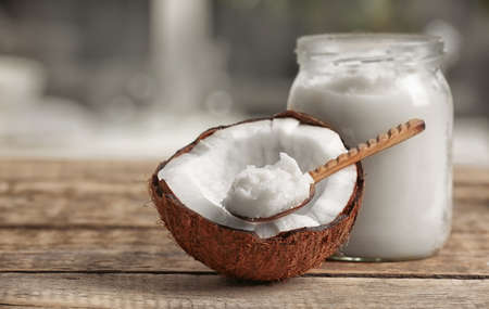 Fresh coconut oil on wooden table