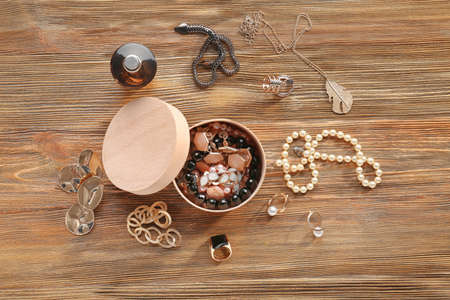 Jewelry accessories in box and table, top view Stok Fotoğraf