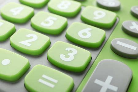 Green calculator, closeup Imagens
