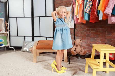 Cute little girl in dressing room