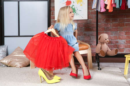 Cute little girl with skirt in dressing room