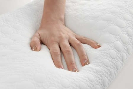 Female hand on orthopedic pillow, closeup
