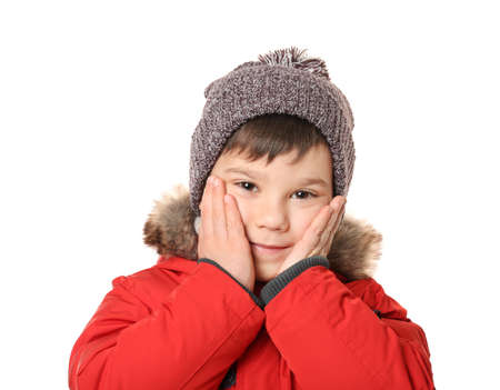 Cute little boy in warm clothes on white background
