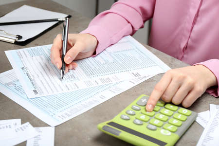 Businesswoman working with documents. Tax concept