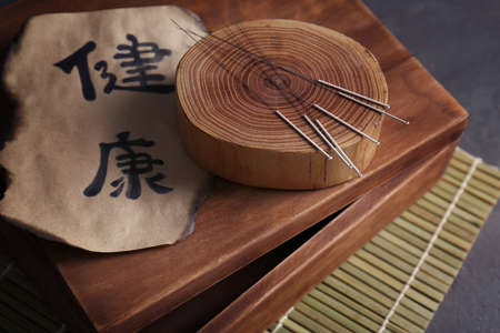 Set of needles for acupuncture on wooden stump