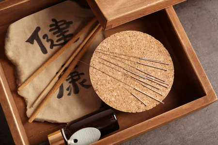 Professional wooden box with needles and tools for acupuncture procedure