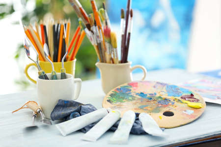 Different artists accessories on table