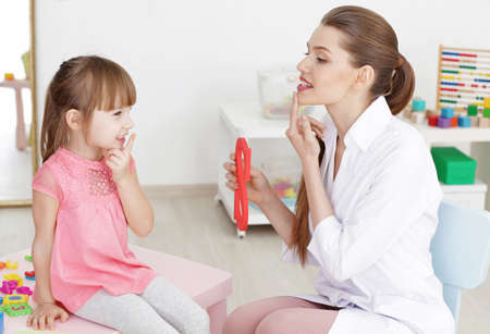 Cute little girl at speech therapist office Stock Photo
