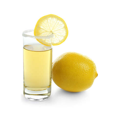 Golden tequila shot with juicy lemon slice and salt on white background Stock Photo