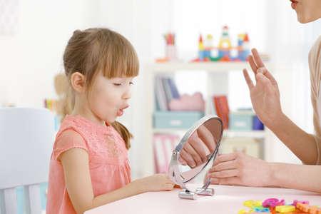 Cute little girl at speech therapist office Stock Photo