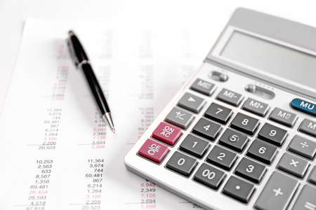 Health planning concept. Calculator and pen on bill background Stock Photo