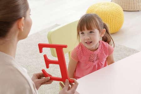 Cute little girl at speech therapist office Imagens