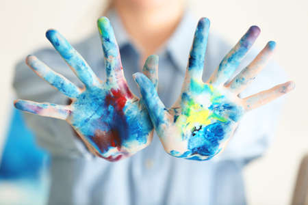 Female artist's hands in paint, closeup