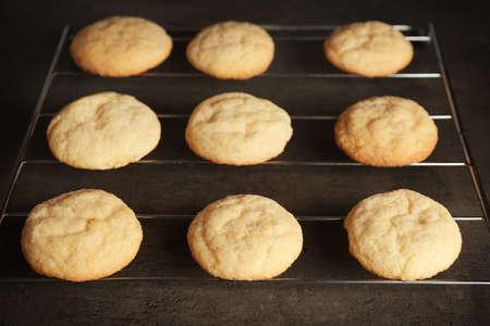 Tasty sugar cookies on grid