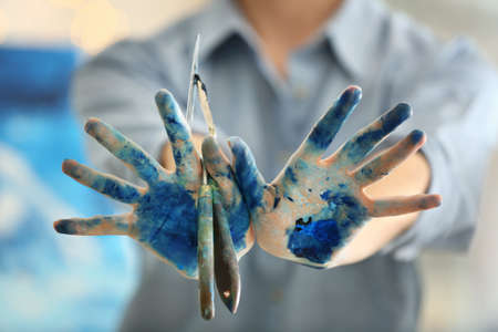 Female hands with artists tools, closeup Stock Photo