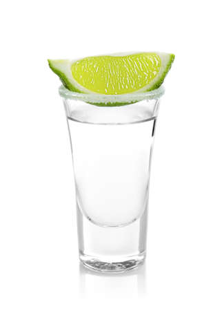 Tequila shot with juicy lime slice and salt on white background Standard-Bild - 103262315