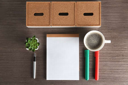 Empty notebook with pen, cup of coffee and accessories on table. Job interview concept