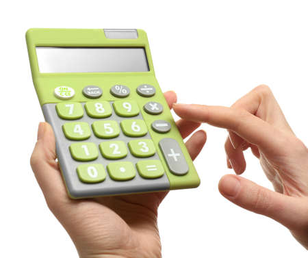 Female hands holding calculator, isolated on white