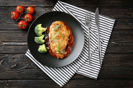 Delicious chicken parmesan meal with broccoli on plate