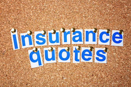 Text INSURANCE QUOTES on cork background