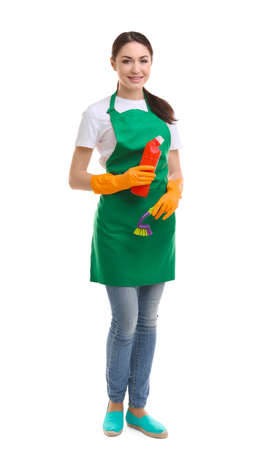 Young woman holding cleaning supplies on white background