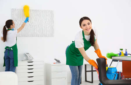 Cleaning service team at work in office