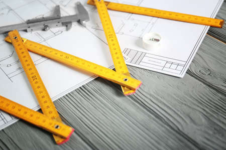 Blueprints and engineer supplies on table Banque d'images