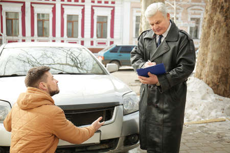 Driver explaining details of accident to loss adjuster