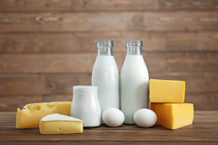 Different dairy products on wooden table