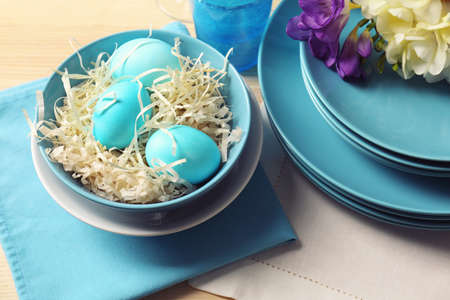 Beautiful Easter table setting with blue plates Reklamní fotografie