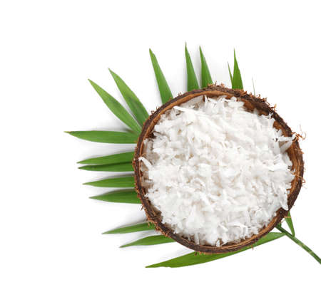 Grated coconut in shell on white background