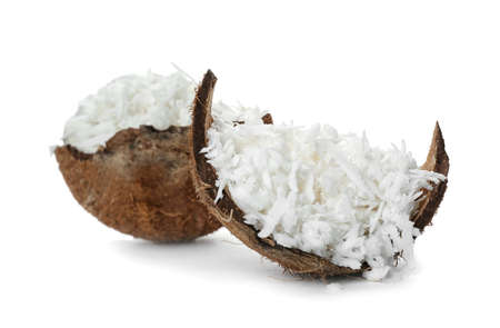 Coconut flakes and fresh nut on white background