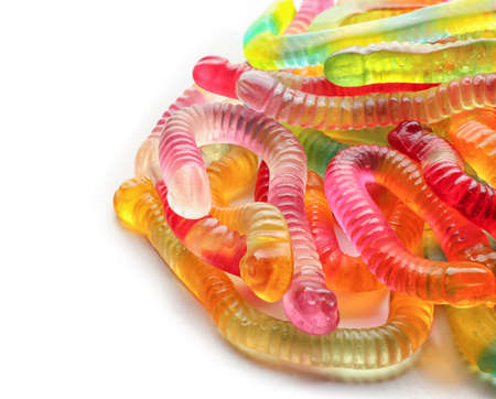 Tasty jelly worms on white background, closeup