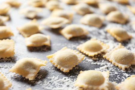 Uncooked ravioli on table, closeup