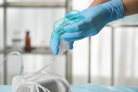 Doctor preparing compressor nebulizer for use