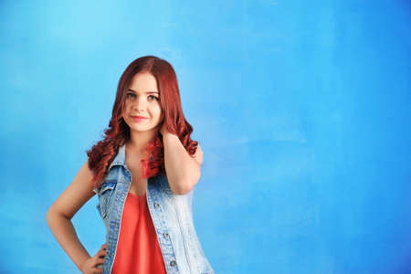Beautiful young woman with dyed hair on color background Stock Photo