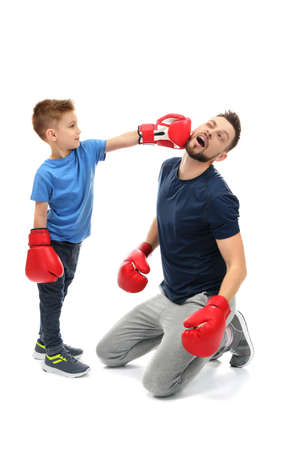 Father and son during boxing training, on white background 写真素材