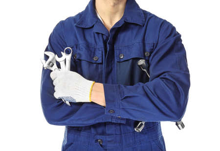 Auto mechanic with tools on white background, closeup