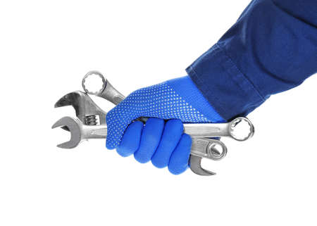 Hand of auto mechanic with tools on white background